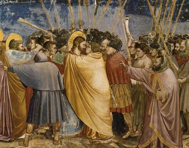 Jesús es apresado (1302-6), por el Giotto (1267-1337). Judas besa a Jesús. San Pedro, detrás de él, usa la espada. Fresco en la Capilla de los Scrovegni, en Padua